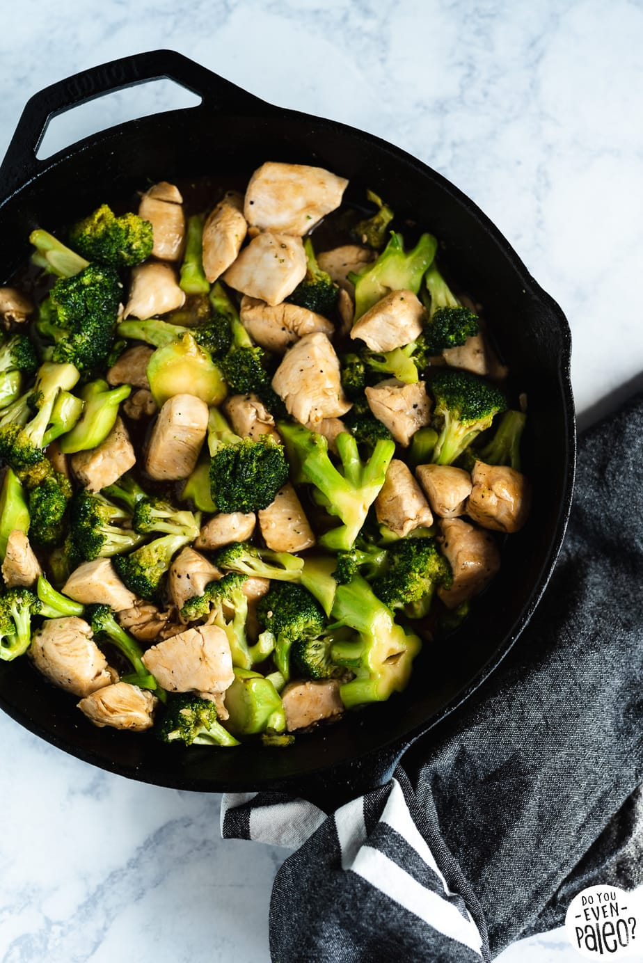 Quick & Easy Paleo Chicken & Broccoli Stir Fry Recipe in a large skillet by DoYouEvenPaleo.net