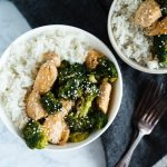 Quick & Easy Whole30 Chicken & Broccoli Stir Fry Recipe in a white bowl next to a dark napkin by DoYouEvenPaleo.net