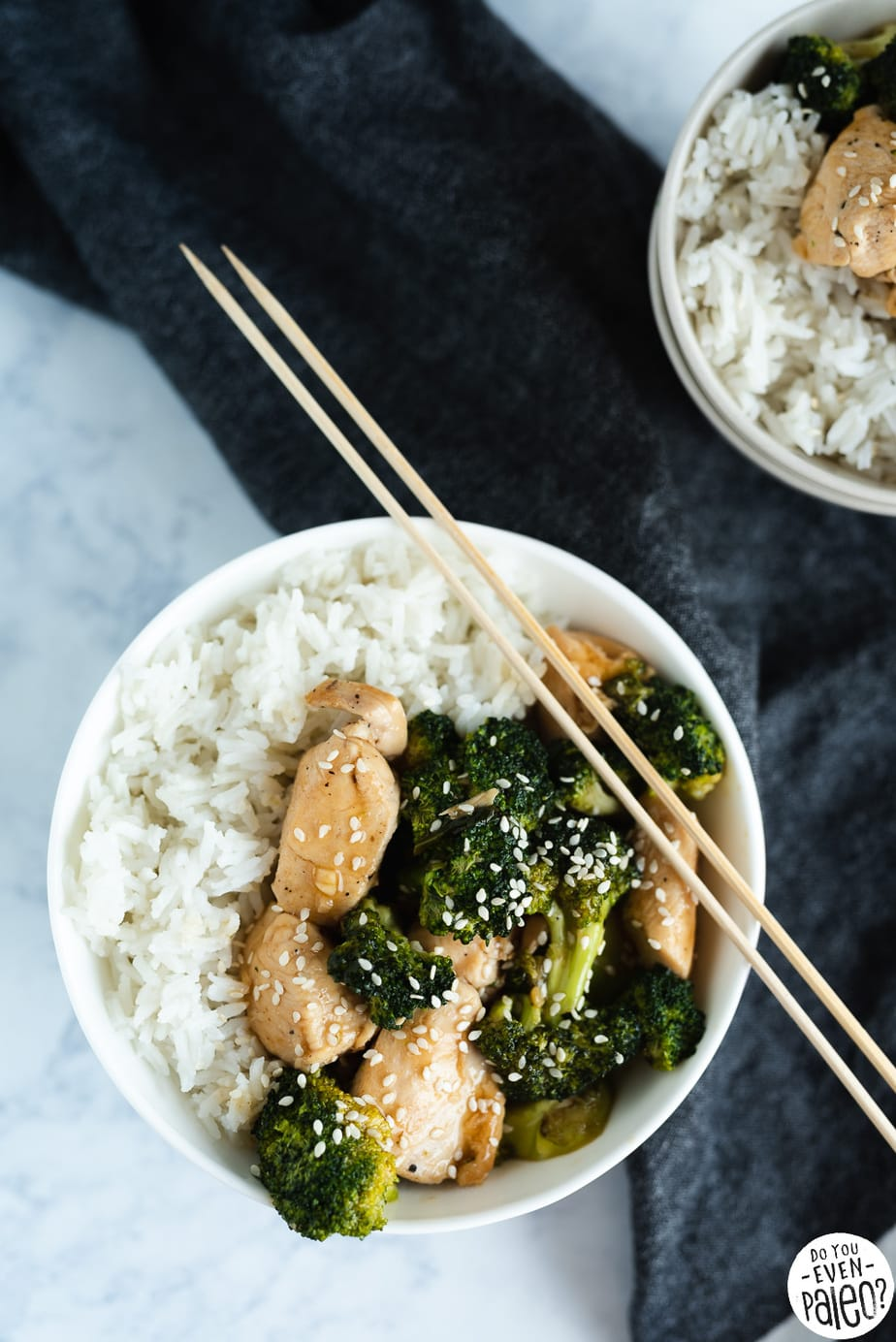 Quick & Easy Chicken & Broccoli Stir Fry Recipe ingredients with a dark napkin on a marble background by DoYouEvenPaleo.net
