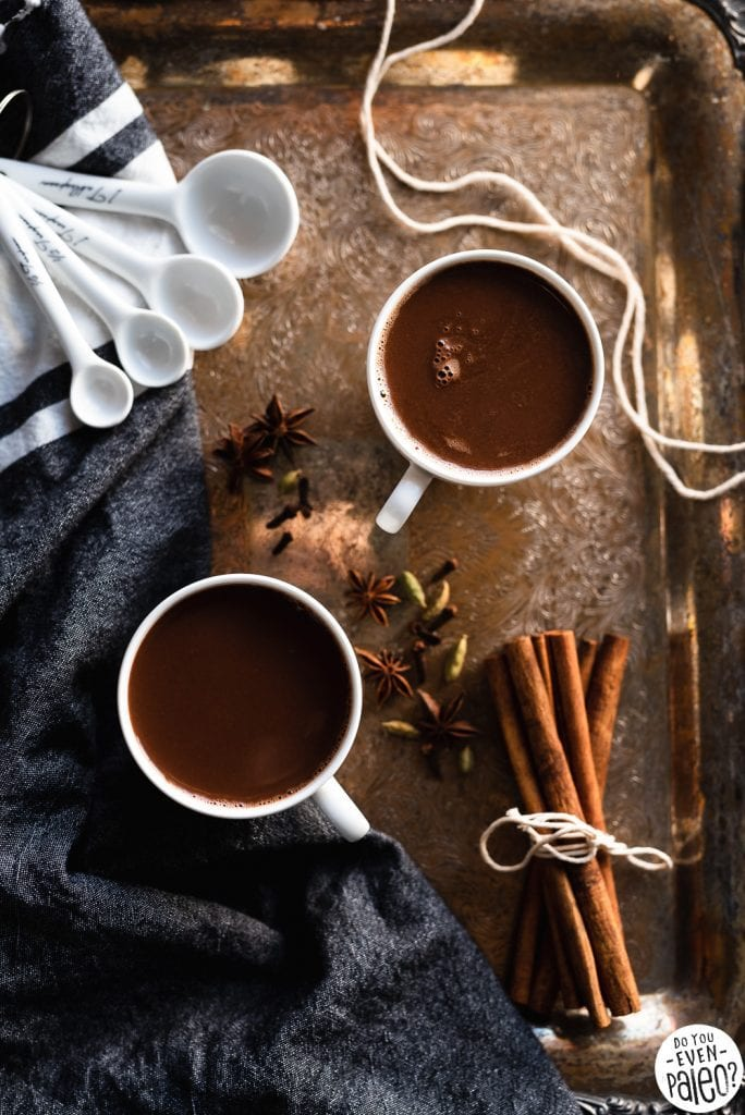 Mugs of dairy free chai hot chocolate on a vintage tray styled with spices | DoYouEvenPaleo.net
