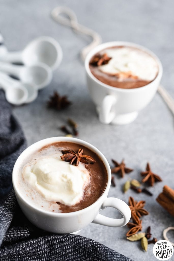 Mugs of dairy free chai hot chocolate styled with spices | DoYouEvenPaleo.net
