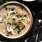 Bowls of dairy free chicken and mushroom soup on a dark background | DoYouEvenPaleo.net