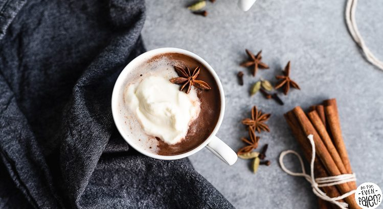 Mug of dairy free chai hot chocolate styled with spices and linens | DoYouEvenPaleo.net