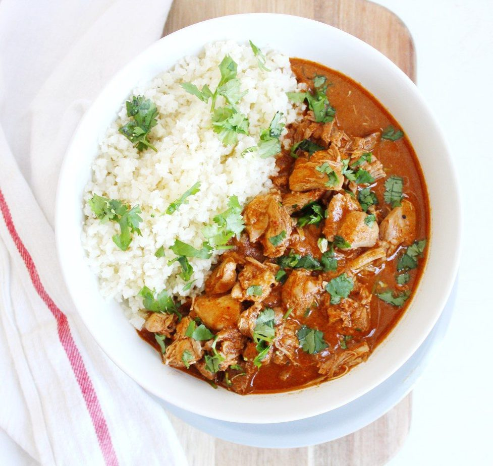 Bowl of instant pot indian butter chicken recipe with cauliflower rice