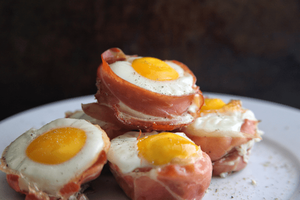 Prosciutto Egg Cups stacked on a white plate