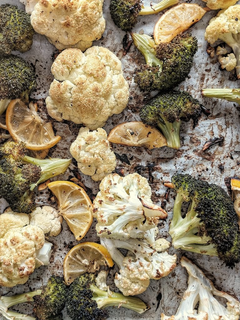Sheet pan with roasted broccoli and cauliflower