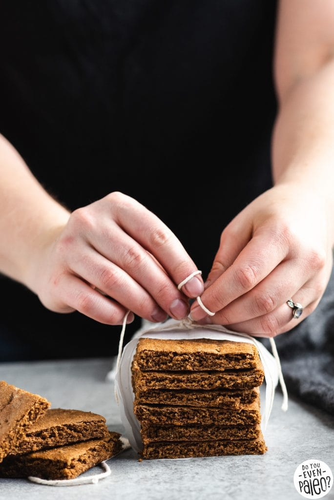 Hands tying string around a stack of paleo graham crackers