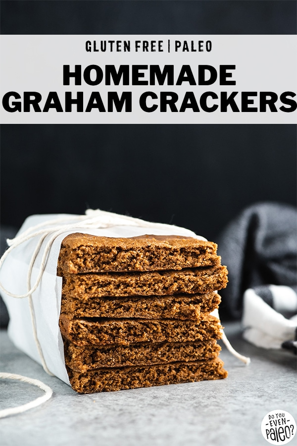Homemade graham crackers stacked up and wrapped in parchment paper, with text overlay 'Homemade Graham Crackers'