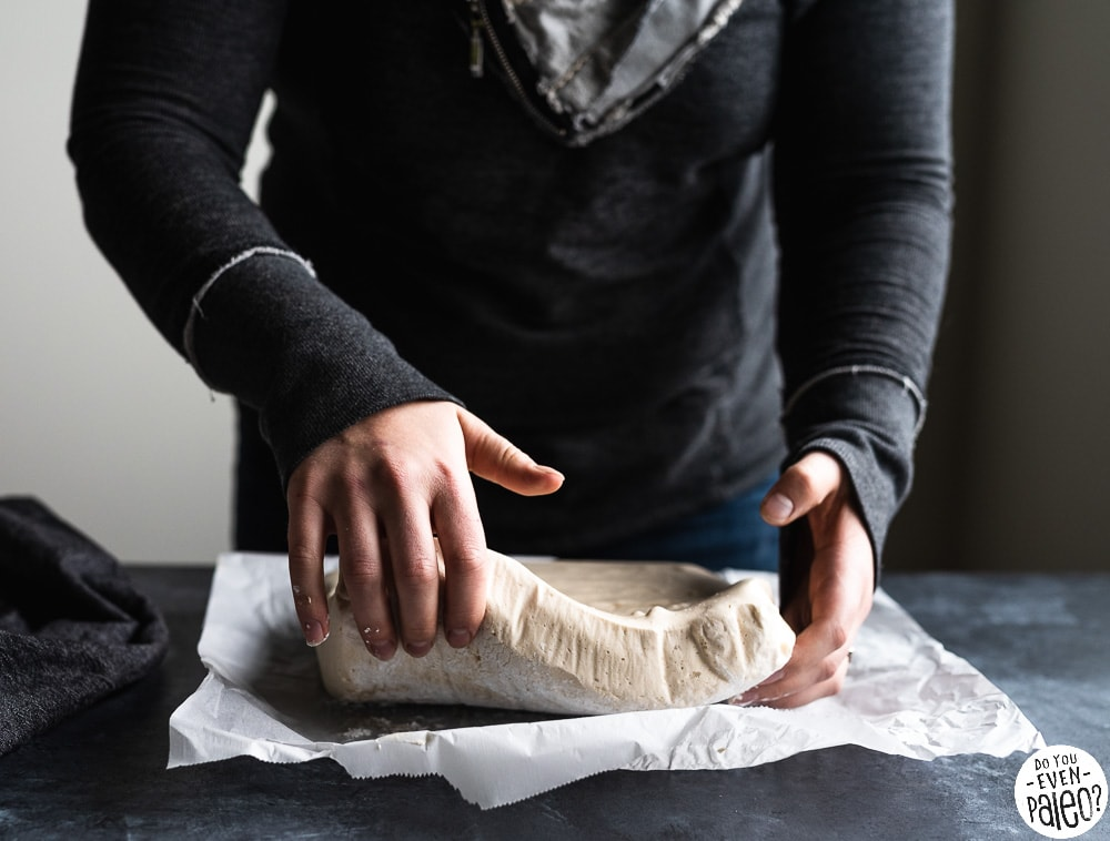Woman picking up homemade marshmallows before they have been sliced
