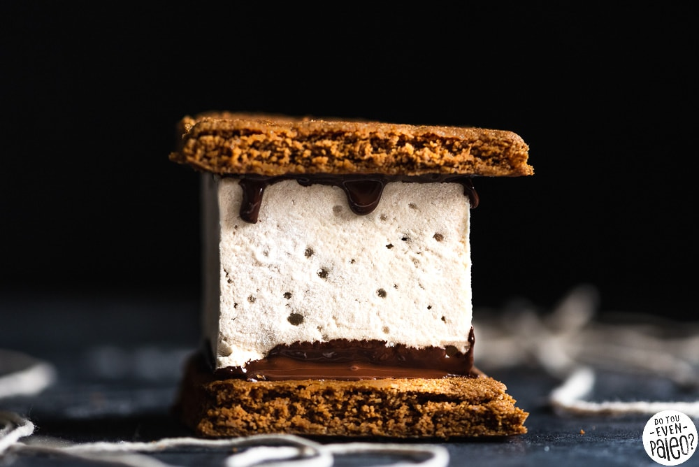 Paleo s'mores bar with homemade graham crackers, melted chocolate, and homemade marshmallows