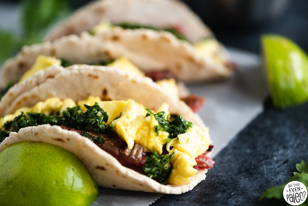 Paleo Steak and Egg Breakfast Tacos with Chimichurri on parchment paper