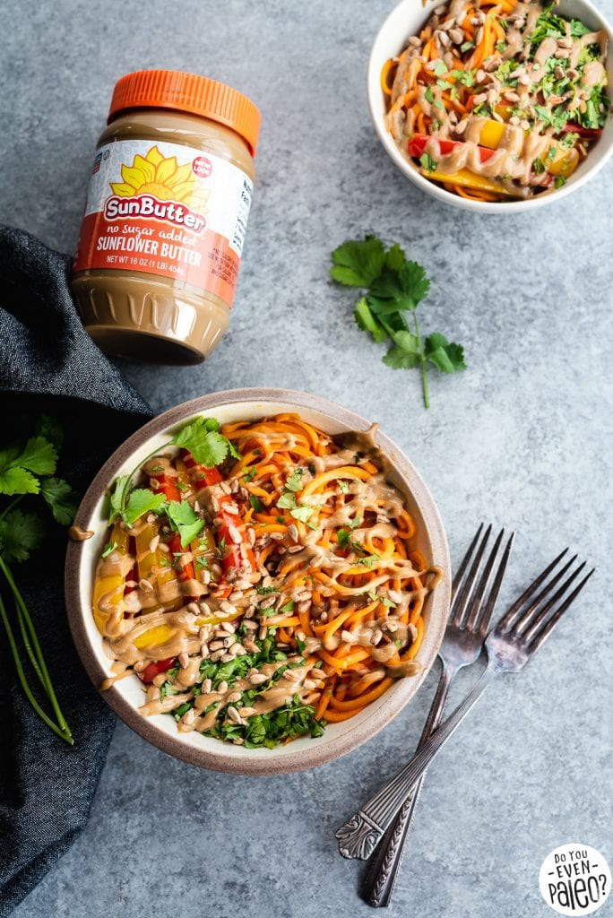 Thai sweet potato noodle bowls recipe with two forks and linens