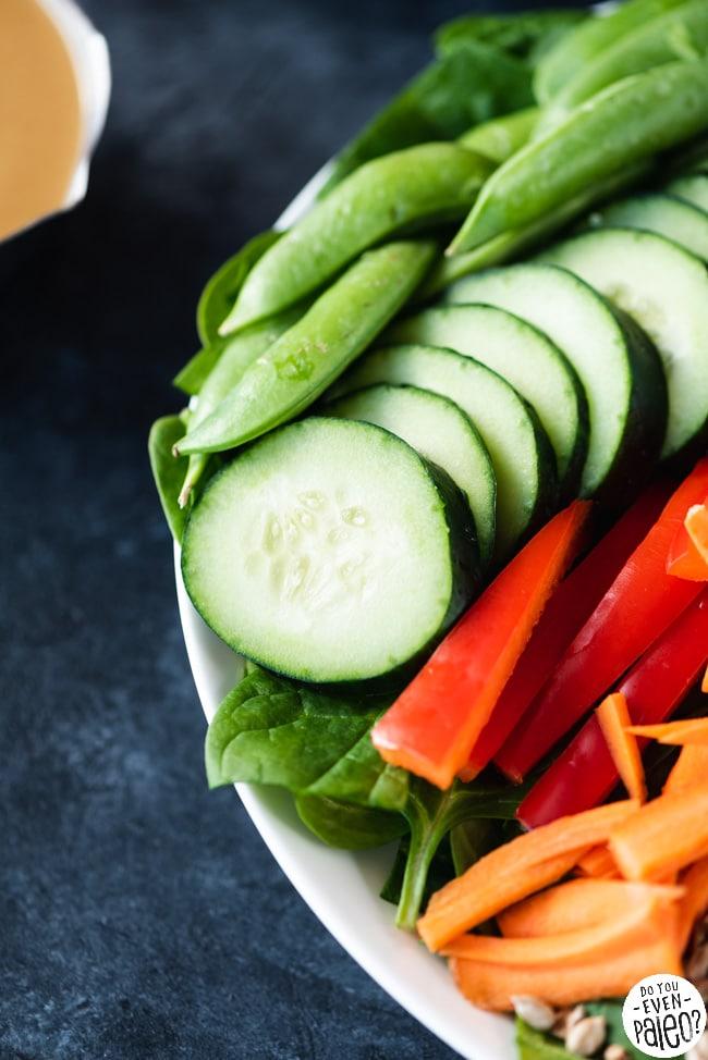 Closeup of gluten free Chopped Spinach Salad with Sunbutter Vinaigrette