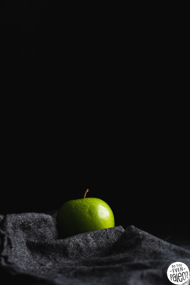 Image of a green apple against a dark background
