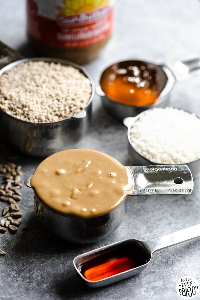 Ingredients for no bake SunButter energy bites in measuring cups