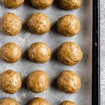 SunButter no bake energy balls on a parchment paper lined baking sheet
