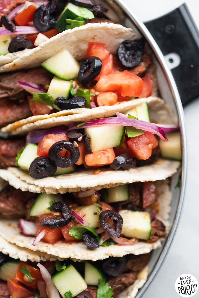 Paleo Steak Tacos with Greek Salsa arranged on a stainless steel tray