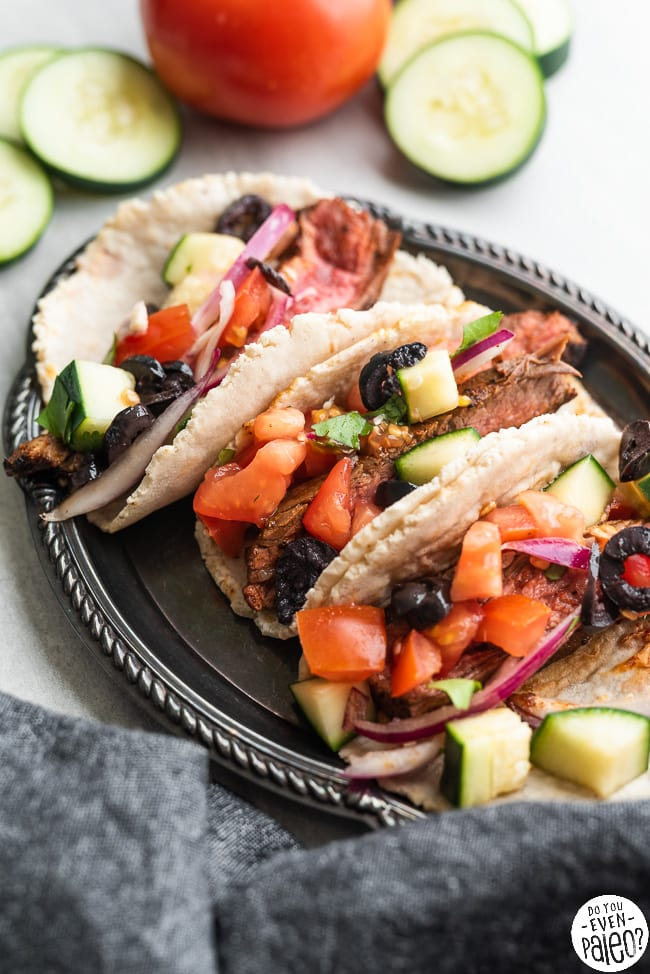 Three gluten free paleo steak tacos with Greek salsa on a small plate