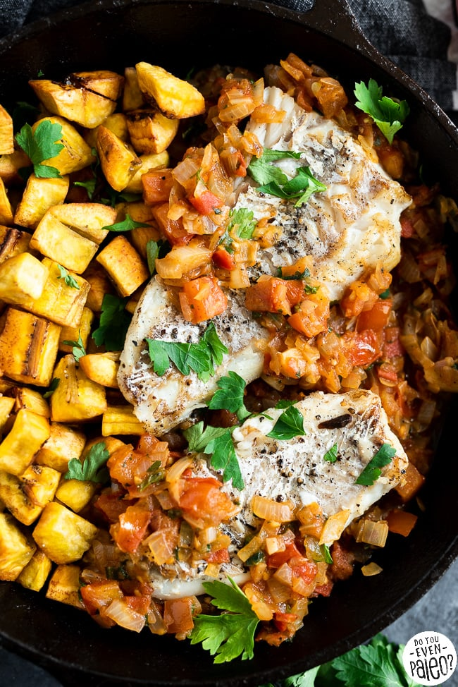 grilled fish with fried plantains in a cast iron skillet