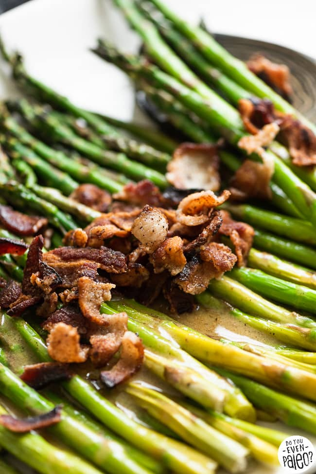 Crumbled bacon and maple vinaigrette on top of gluten free roasted asparagus
