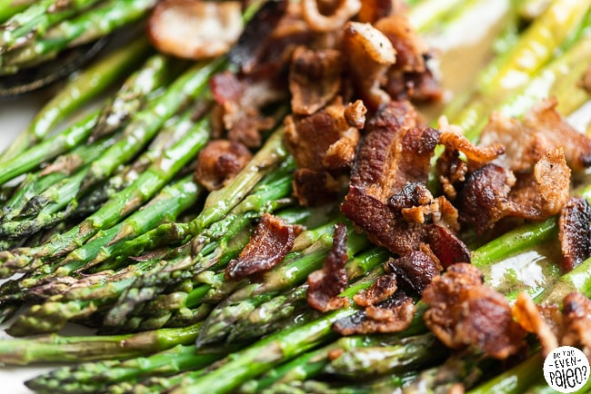 Asparagus topped with crumbled bacon and a maple-mustard vinaigrette
