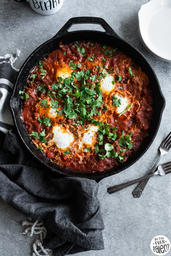 Cast iron skillet with Whole30 chorizo shakshuka garnished with cilantro