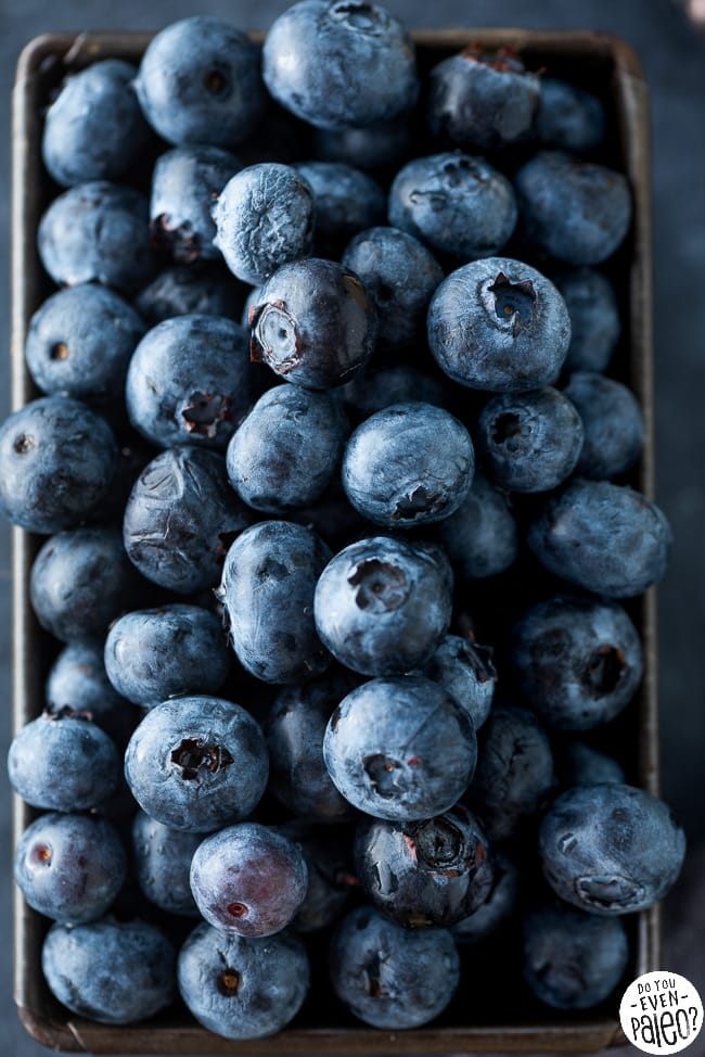 Tin piled with fresh blueberries