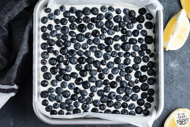Pan of gluten free lemon blueberry cheesecake bars