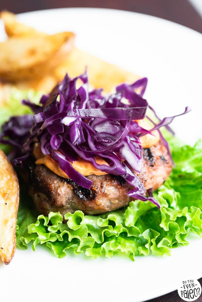 Bunless pork burger topped with mayo and red cabbage