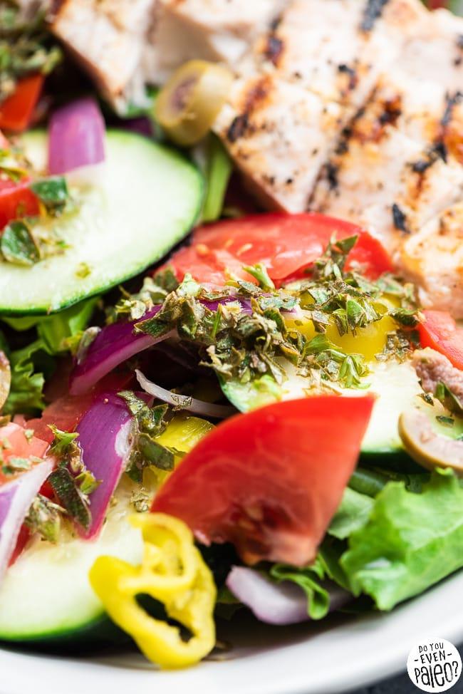 Closeup of Greek salad dressed with lemon oregano vinaigrette