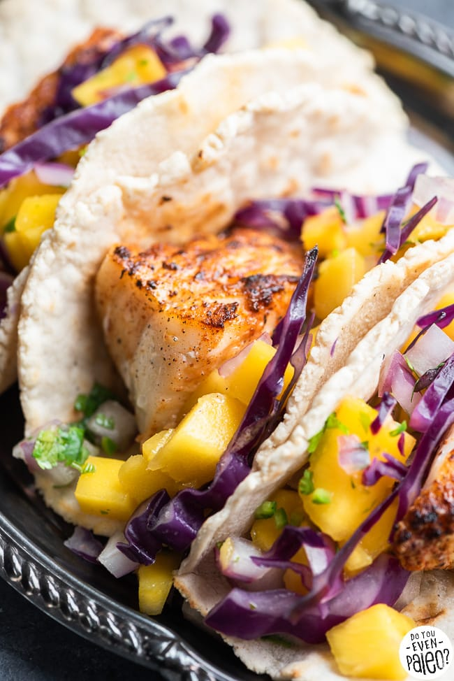 Closeup of paleo fish tacos with mango salsa