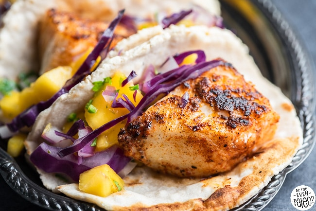 Closeup of paleo fish tacos with mango salsa