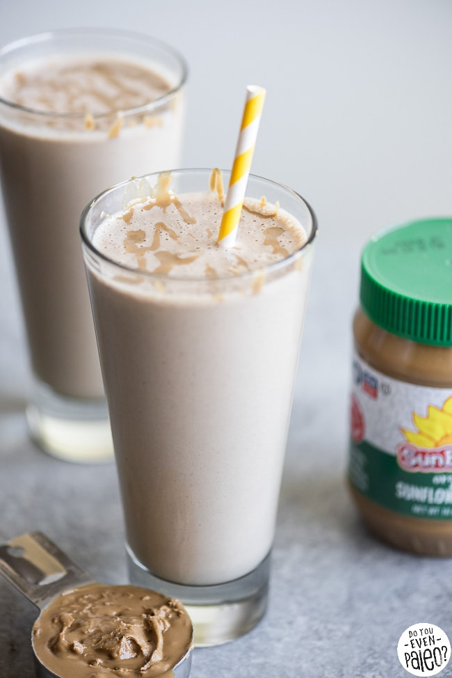Two SunButter maca smoothies in tall glasses