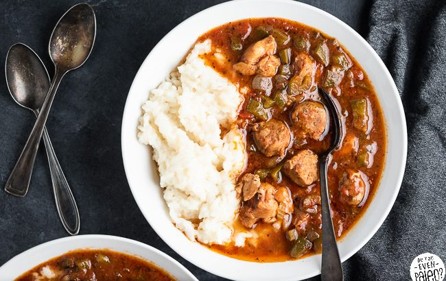 Bowl of slow cooker gumbo with rice and a spoon