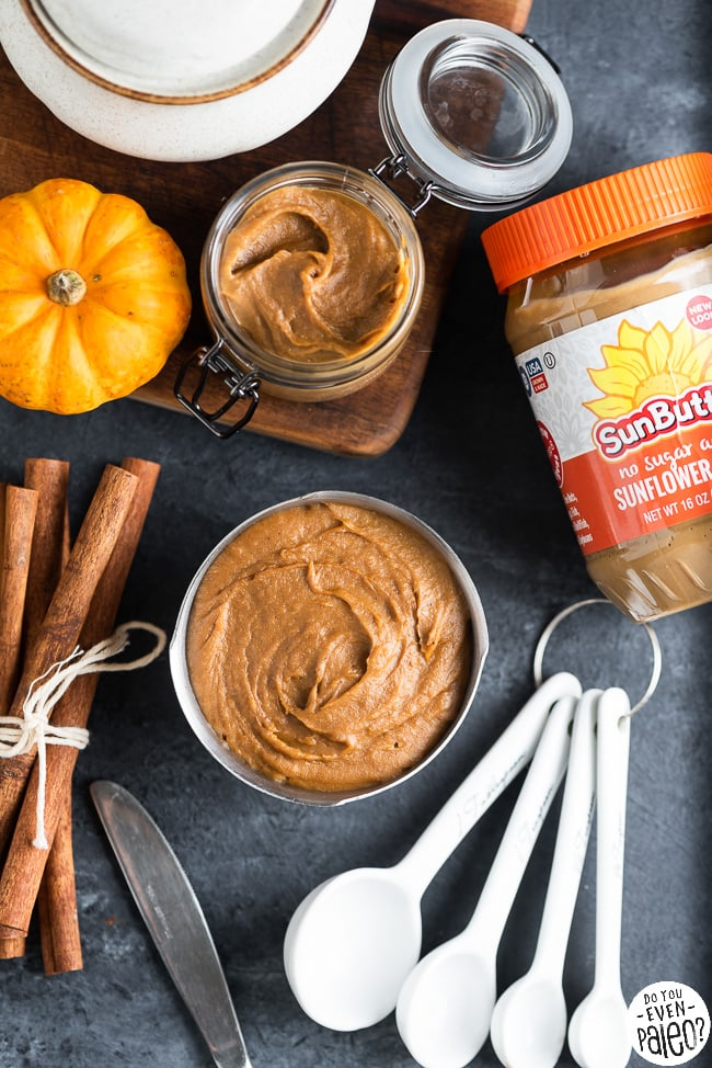 Dish with SunButter pumpkin butter arranged with ingredients and measuring spoons