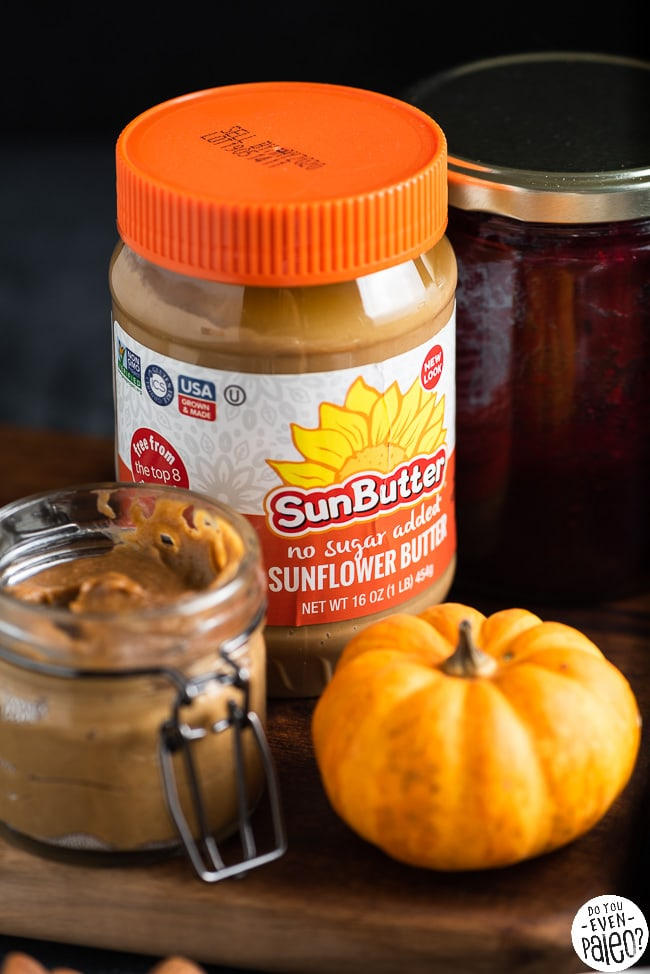 Container of SunButter next to a small pumpkin and a jar of spread
