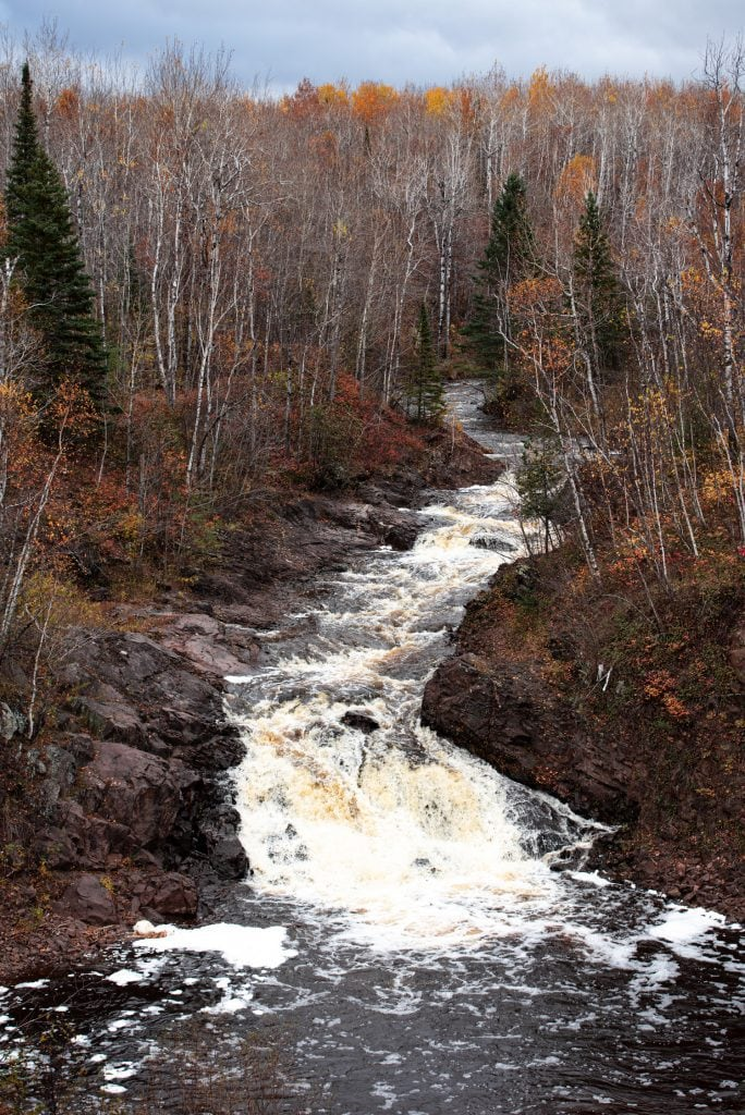 View of river, waterfall, and forest in Duluth's Lester River Park