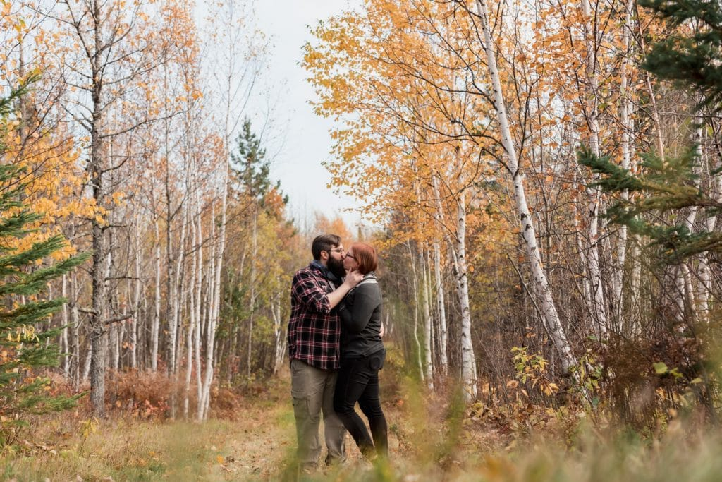 Couple kissing in the midst of birch trees in fall | Chelsea Joy Photography