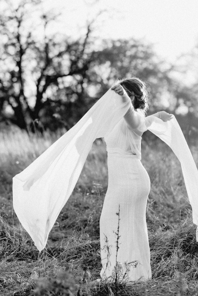 Woman in wedding dress with long, flowing sleeves