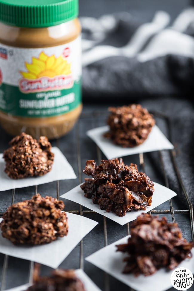 Closeup of SunButter no bake cookies with a jar of SunButter in the background
