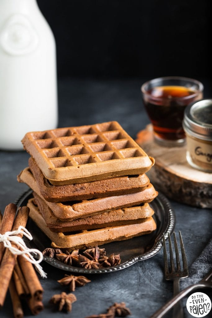 Stack of gluten free waffles on a vintage plate with cinnamon sticks and star anise