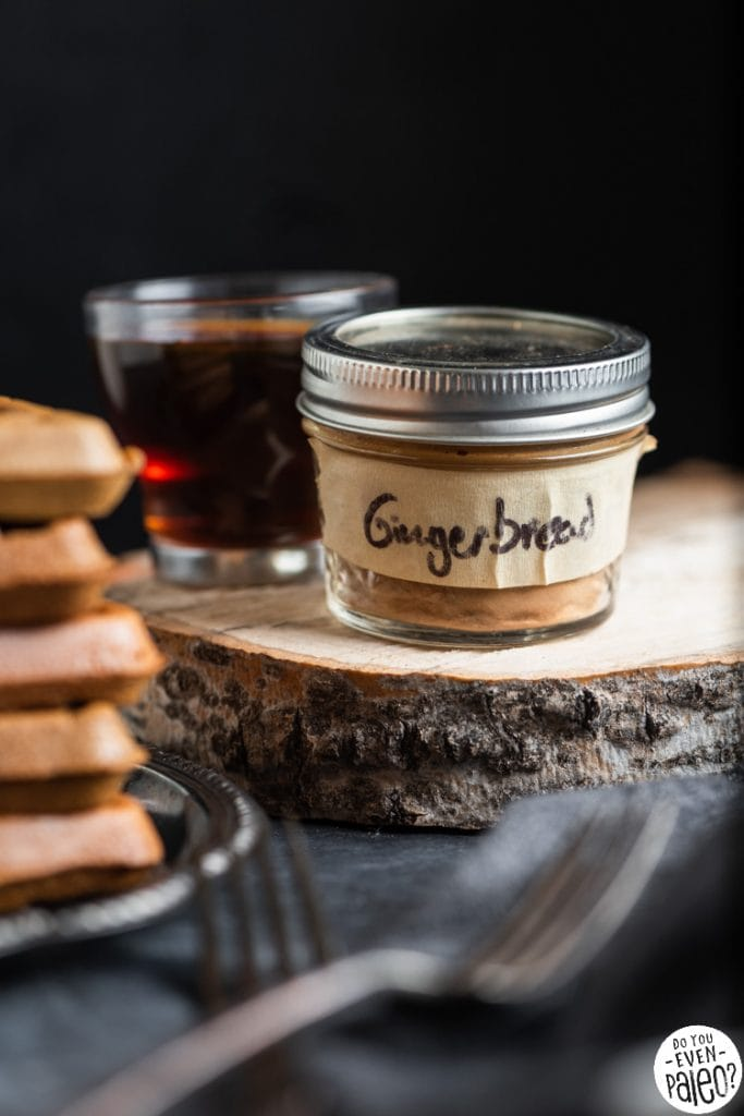 Closeup of a small mason jar with the phrase 'gingerbread' written on a strip of tape