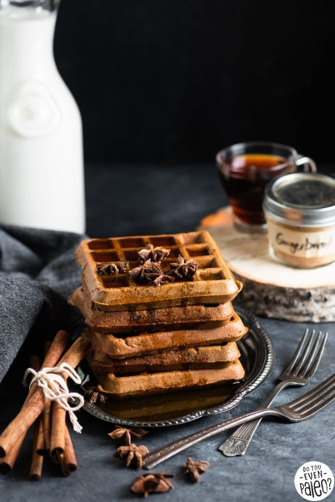 Waffles on a vintage plate garnished with star anise and sticks of cinnamon