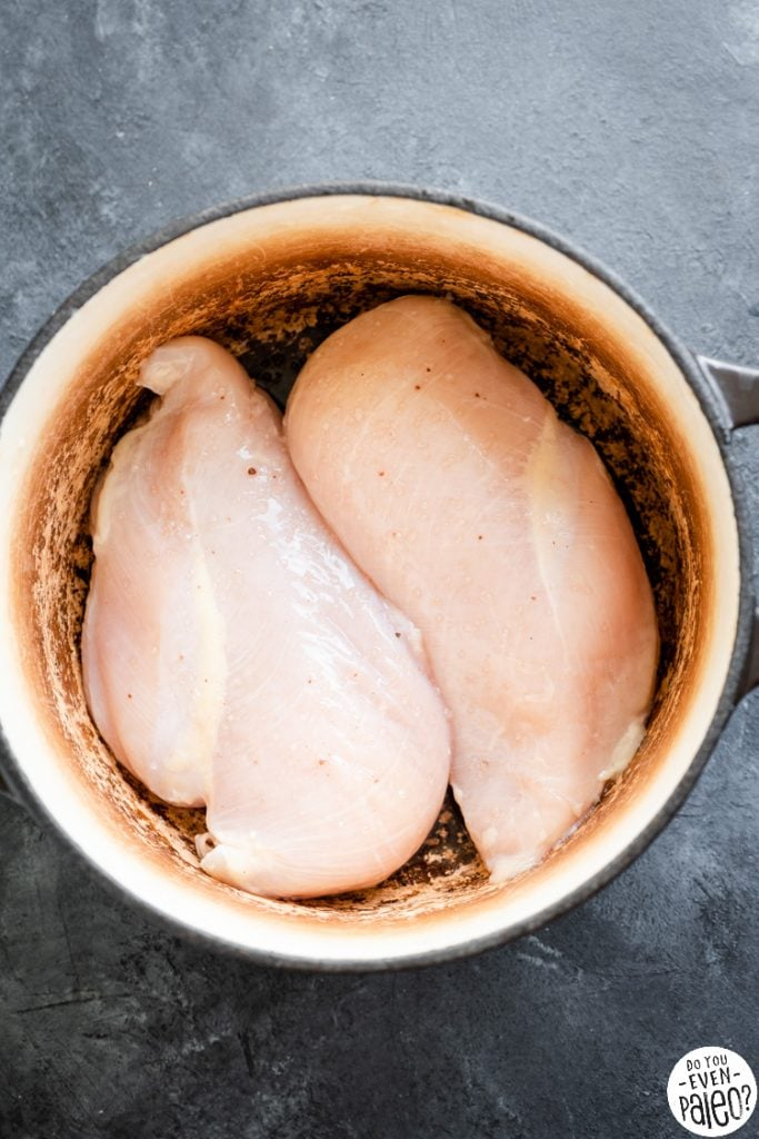 Raw chicken breasts sprinkled with salt in a dutch oven