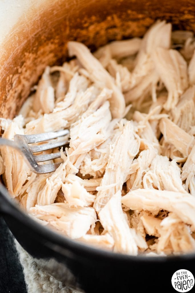Closeup of shredded chicken in a dutch oven