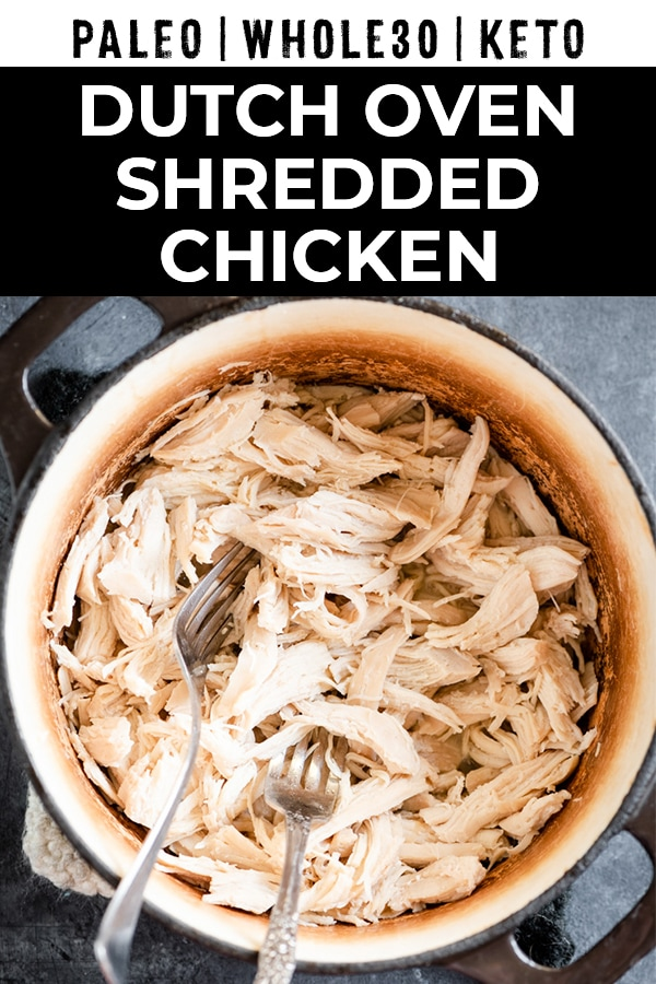 "Shredded chicken in a dutch oven with text overlay ""dutch oven shredded chicken"""