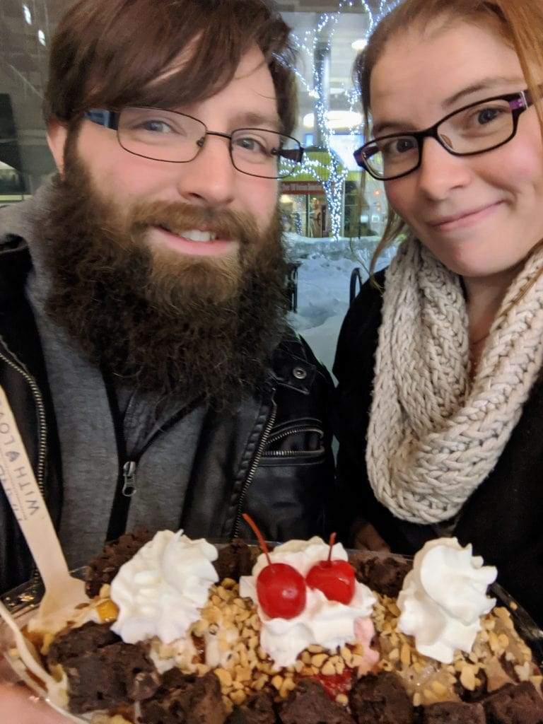 A couple with a brownie banana split at Silver Lining Creamery