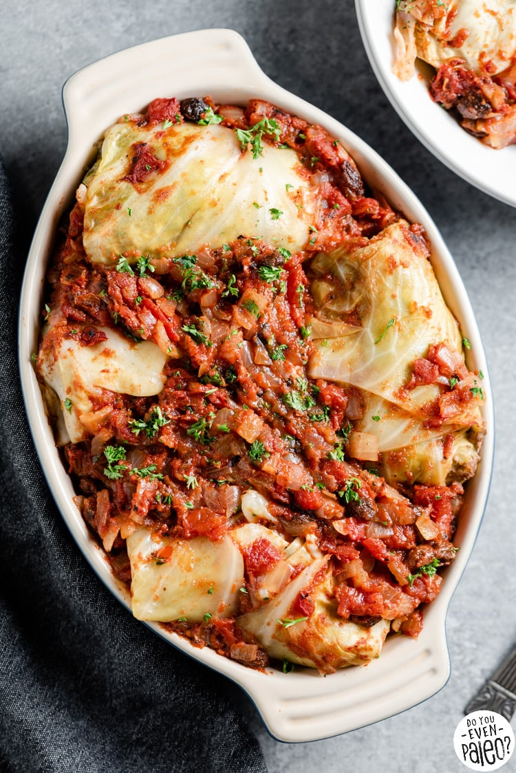 Closeup of cabbage rolls in an oval casserole dish