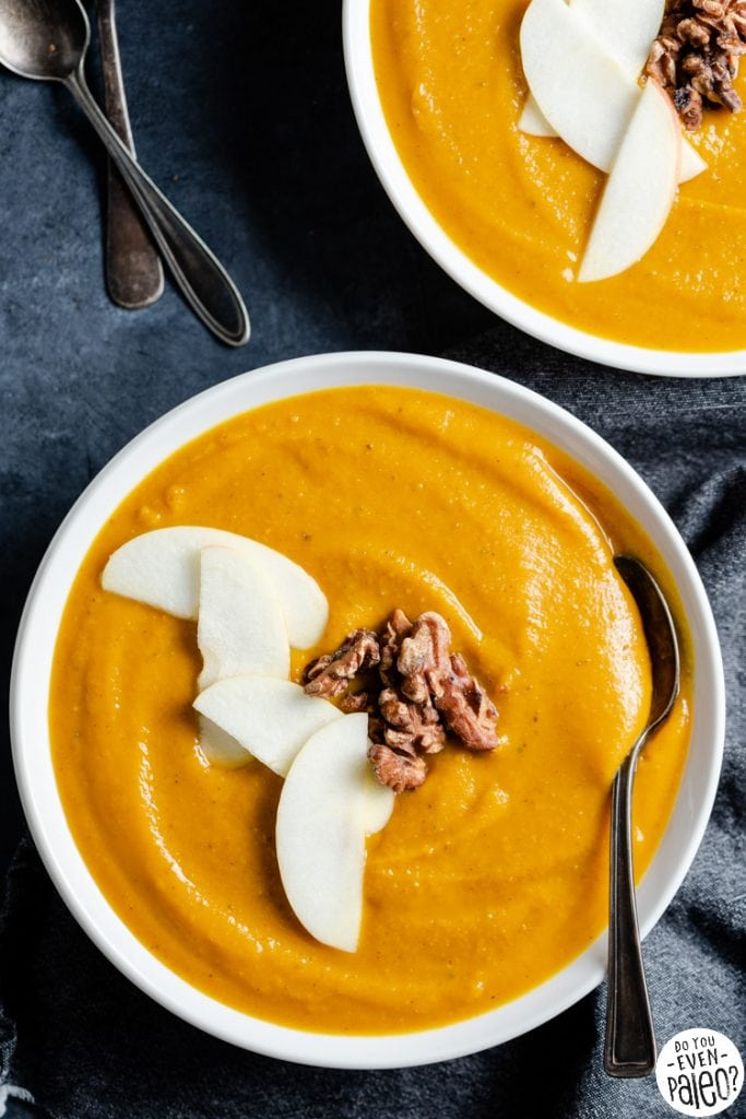 Closeup of a bowl of roasted squash and apple soup