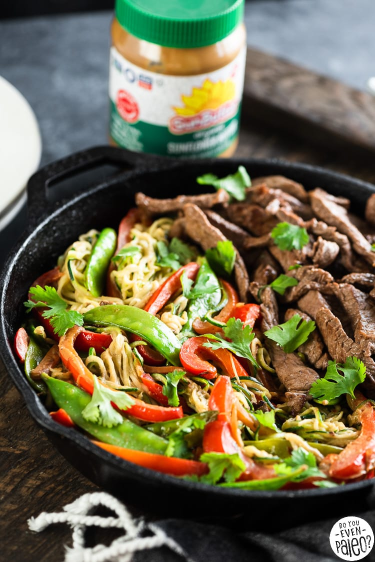 Skillet of beef stir fry with colorful vegetables and zucchini noodles